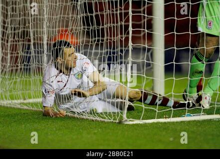 Burnley's Dean Marney ends up in the back of the net after going close - Stock Photo