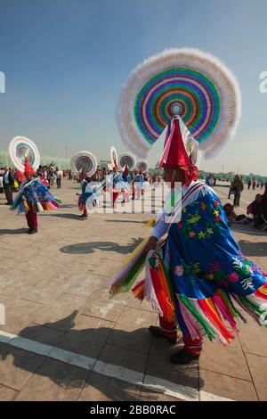 Totonacan indigenous dancers from Papantla-Veracruz in traditional costumes, perform the Dance of the Guaguas at the pilgrimage to Our Lady of - Stock Photo