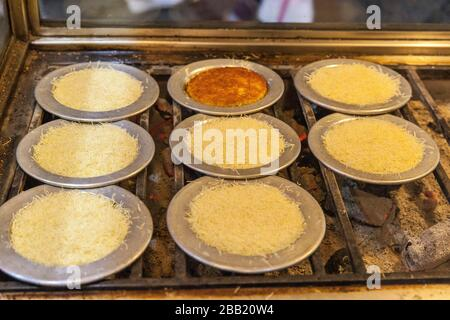 traditional Turkish delicious dessert Kunefe, istanbul, Turkey. - Stock Photo