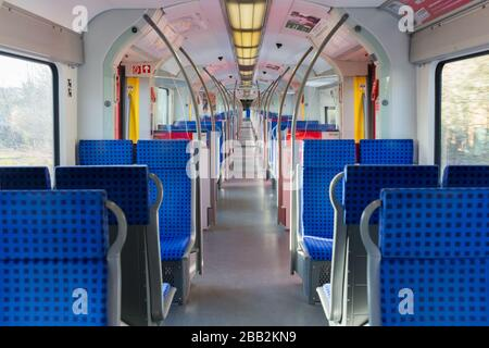 Interior view of an empty S-Bahn (public transport train). The number of people which use public transport significantly decreased due to Coronavirus.