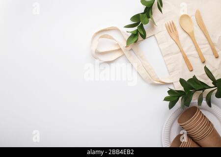 Eco friendly knife, fork, spoon on cotton bag - Stock Photo