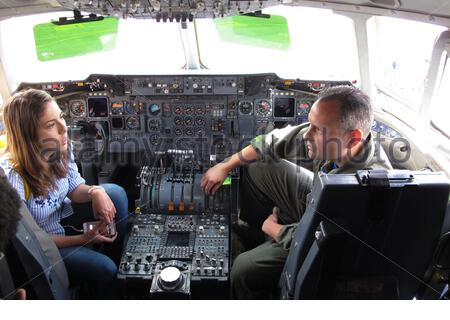 'English: Juanita Gomes, a reporter from Noticias Caracol television in Bogota, interviews U.S. Air Force Senior Master Sgt. Russell Downie, with the 79th Aerial Refueling Squadron from Travis Air Force Base, Calif., in the cockpit of a KC-10 during the Colombian Air Force's Feria Aeronautica Internaccional – Colombia in Rionegro,  July 14, 2017. The United States Air Force is participating in the four-day air show with two South Carolina Air National Guard F-16s as static displays, plus static displays of a KC-135, KC-10, along with an aerial demonstration by the Air Combat Command's Viper Ea - Stock Photo