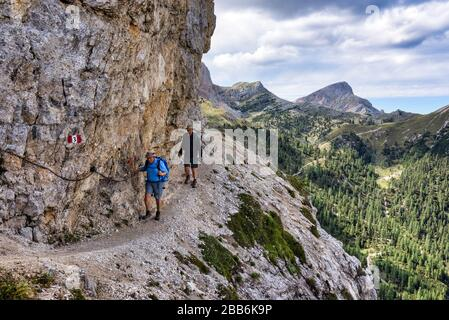 Two men hiking in the Dolomites, South Tyrol, Italy - Stock Photo