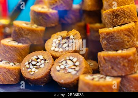 Various types or many colorful assortment of Turkish delights rolls for sale in a shop in Istanbul, or on the street during street food festival. Loku - Stock Photo