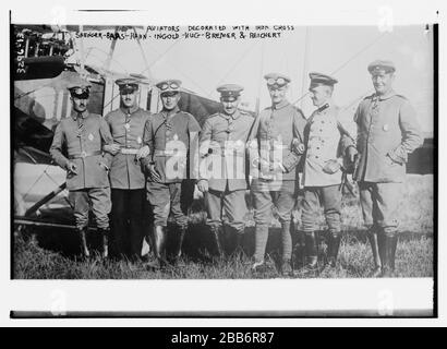 'English: Title: Aviators decorated with iron cross: Saenger -- Baas -- Hahn -- Ingold -- Hug -- Bremer -- Reichert Abstract/medium: 1 negative : glass ; 5 x 7 in. or smaller.; 1910; Library of Congress  Catalog: https://lccn.loc.gov/2014698054 Image download: https://cdn.loc.gov/master/pnp/ggbain/17800/17800u.tif Original url: https://www.loc.gov/pictures/item/2014698054/; Bain News Service, publisher; ' - Stock Photo