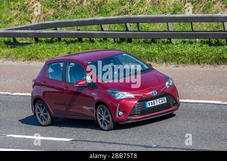 2018 red Toyota Yaris Icon Tech HYB VVT-I; UK Vehicular traffic, road transport, modern vehicles, saloon cars, vehicle driving, roads & motors, motoring south-bound on the M61 motorway highway - Stock Photo