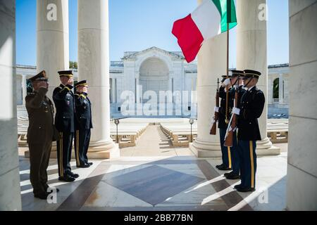 '(From the left) Lt. Gen. Danilo Errico, chief of staff, Italian Army; Maj. Gen. Michael Howard, commanding general, U.S. Army Military District of Washington; and Gen. Mark A. Milley, chief of staff, U.S. Army; renders honors to the Italian flag in the Memorial Amphitheater at Arlington National Cemetery, Arlington, Va., Oct. 17, 2017.  Ericco participated earlier in an Army Full Honors Wreath-Laying Ceremony at the Tomb of the Unknown Soldier and exchanged gifts with Arlington National Cemetery leadership.  (U.S. Army photo by Elizabeth Fraser / Arlington National Cemetery / released); 17 Oc - Stock Photo