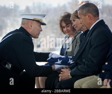 'The Assistant Commandant of the Marine Corps, Gen. John M. Paxton, Jr., his wife Debbie, and Mrs. Bonnie Amos attend the funeral service for Retired Colonel Charles Waterhouse at Arlington National Cemetary, Arlington, VA, Feb. 19, 2014. Col. Waterhouse was a combat artist and was seriously injured during the first wave of Iwo Jima. He suffered from sever nerve damage in his left hand but was still able to paint with his right and continued though out his life to paint artwork up until three weeks before he passed away. (U.S. Marine Corps photo by Cpl. Tia Dufour/Released); 19 February 2014, - Stock Photo