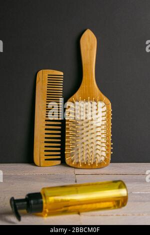 Hair gel and comb for haircut stand on a white table. Hairdressing concept