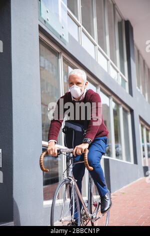 Middle aged man wearing coronavirus Covid 19 mask on the go