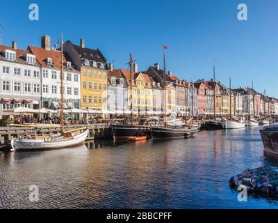 Nyhavn canal and promenade with its colourful facades, 17th century waterfront, Copenhagen, Denmark