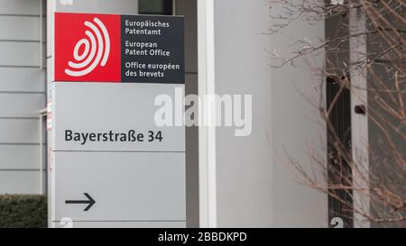 Signpost in front of the European Patent Office (EPO) Headquarters at Bayerstraße. With an arrow pointing towards the entrance. Patent registration.