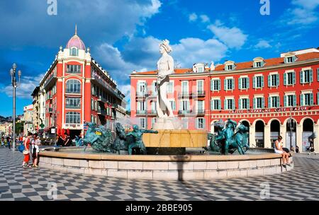 NICE, FRANCE - MAY 15: A view of the fountain Fontaine du Soleil at the Place Massena square on May 15, 2015 in Nice, France. The Place Massena is the - Stock Photo