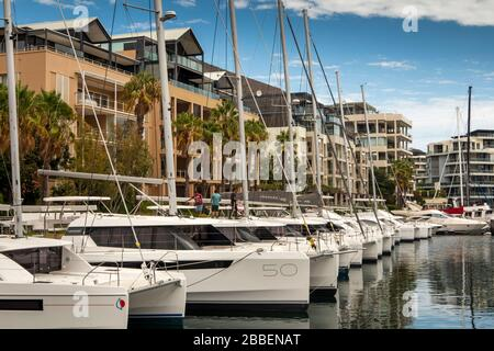 South Africa, Western Cape, Cape Town, Victoria and Alfred Waterfront, luxury social leisure craft moored outside, expensive waterside housing - Stock Photo