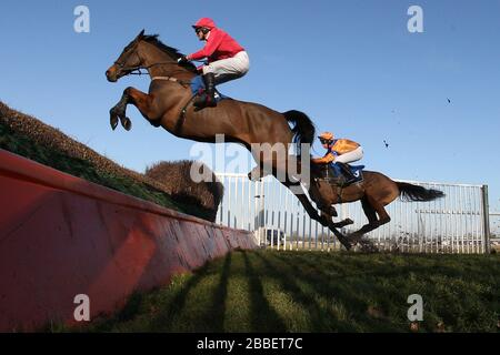 Rockandahardplace ridden by Mr G Barfoot-Saunt in jumping action during the Weatherbys Cheltenham Festival Betting Guide Novices Chase . - Stock Photo