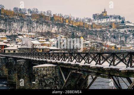 View of Tsarevets fortress and bishops bridge over River Yantra in winter Veliko Tarnovo Bulgaria - Stock Photo