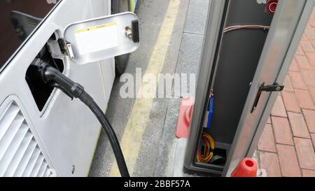 electric bus charging battery from power generated point on street in south Korea - Stock Photo