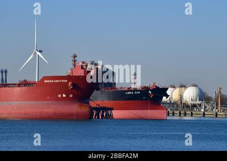 Rotterdam, The Netherlands-March 2020: Close up view of two docked Chemical and Oil Products Tanker in the 7th petroleum harbor with a tank farm in th