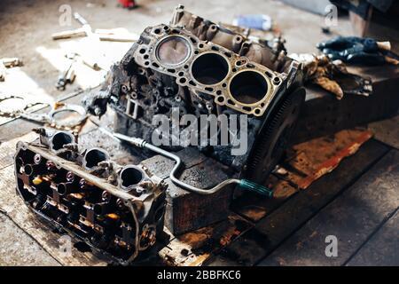 dirty auto engine in garage - Stock Photo