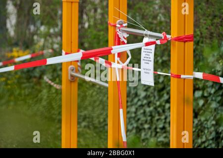 Darmstadt, Germany, Mar 28 2020: The children's playground area closed due to Covid-19. - Stock Photo