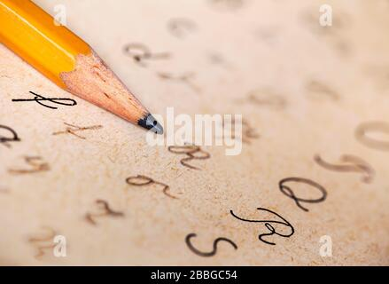 Dyslexia concept, pencil and alphabet letters handwriting, homework