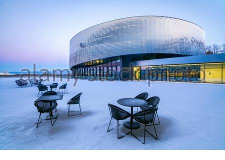 Aquatis (Lausanne, Switzerland) under snow in winter. Aquatis is the largest fresh water aquarium in Europe - Stock Photo