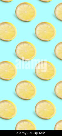Seamless pattern of lemon slices on blue background. Minimal isometric food texture - Stock Photo