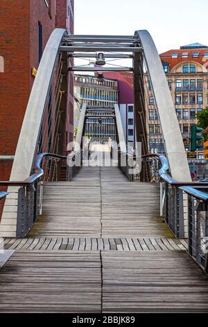 Kibbelsteg bridge over Brooksfleet canal in Speicherstadt warehouse district in Hamburg city, Germany