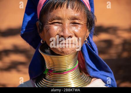 Pan Pet, Kayah State, Myanmar - February 2020: Portrait of an elderly Kayan longneck woman or Paduang wearing traditional brass neck rings.
