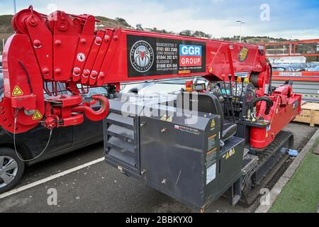 LLANTRISANT, WALES - FEBRUARY 2020: Mini telescopic crane used for building work parked in  care park in Talbot Green, Llantrisant. - Stock Photo