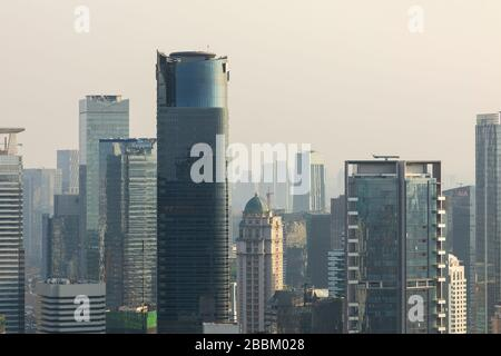 Jakarta, Indonesia - October 20, 2019: Close up of the skyline of the city of Jakarta, Indonesia, Java island, submerged by the dense smoke.