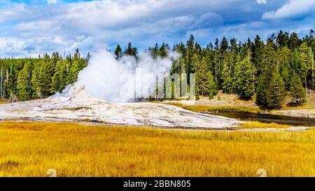 Hot water from the Giant Geyser flowing into the Firehole River in the Upper Geyser Basin along the Continental Divide Trail in Yellowstone