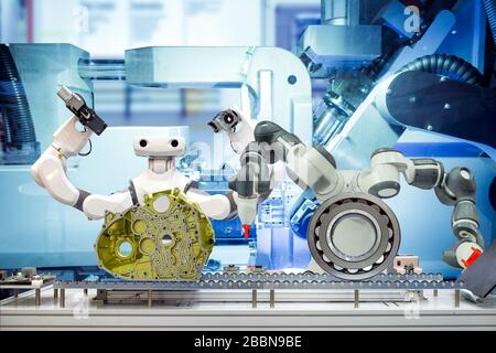 Two industrial robotics working automation with auto parts and spherical roller bearing via a conveyor belt, on machine blue tone color background - Stock Photo