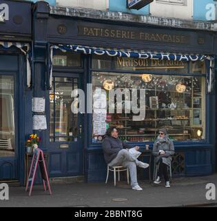 © 2020 Andrew Baker 21st March 2020. A couple defy the UK Governments advice to stay at home to prevent the spread of the Corona Virus in Soho, London. - Stock Photo