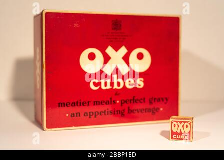 Old vintage OXO cubes tin and OXO cube - Stock Photo