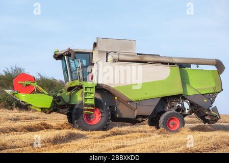 Combine harvester harvests ripe wheat. Agriculture . - Stock Photo
