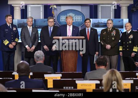 Washington DC, USA. 01st Apr, 2020. United States President Donald J. Trump speaks during a press conference in the Brady Press Briefing Room of the White House on April 1, 2020 in Washington, DC. Pictured behind the President, from left to right: Admiral Karl L. Schiltz, Commandant of the US Coast Guard; United States National Security Advisor Robert C. O'Brien; US Attorney General William P. Barr; US Secretary of Defense Dr. Mark T. Esper; US Army General Mark A. Milley, Chairman of the Joint Chiefs of Staff; and United States Navy Admiral Michael Gilday, Chief of Naval Operations. Credit: M - Stock Photo