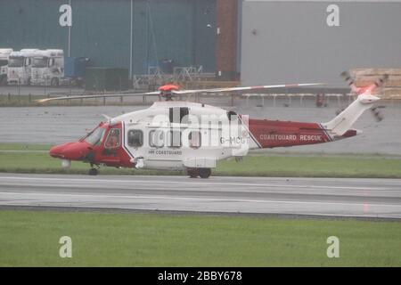 G-MCGT, an AgustaWestland AW189 operated by Bristow Helicopters on behalf of HM Coastguard, during a very dreich day at Prestwick Airport in Ayrshire. - Stock Photo