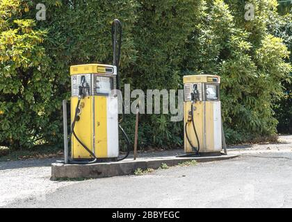 Two old fuel dispensers at a petrol station in Australia - Stock Photo