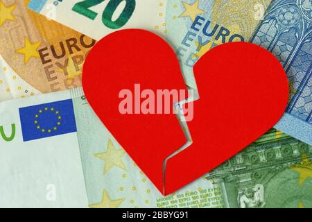 Broken heart on euro banknote - Concept of love and money relationship