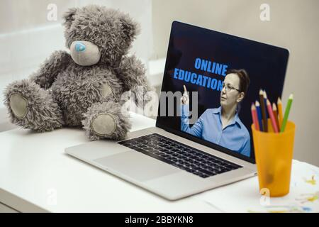 Online education concept. Webinar on a laptop screen. A female coach (tutor) conducts online training. - Stock Photo