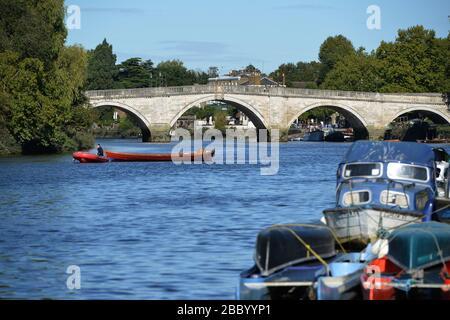 Boats on the Thames by Richmond Bridge, Richmond, London, UK - Stock Photo