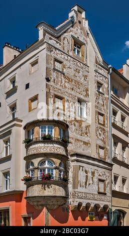 Corner window bay, facade at Under the Quail Basket tenement house, decorated with 16th century sgraffito, in Legnica, Lower Silesia, Poland - Stock Photo