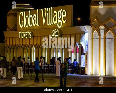 Night time shot of people arriving at Global Village, Dubai, UAE. Global Village combines cultures of 90 countries across the world at one place.