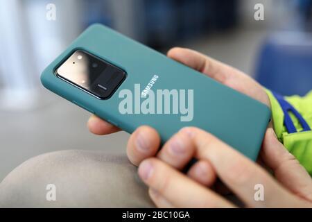 Man holding in hands Samsung Galaxy s20 Ultra closeup - Stock Photo