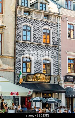 Decorative frontage of the microbrewery and restaurant U Szewca on the street Grodzka in the historical old town of Lublin, Poland. June 2017. - Stock Photo