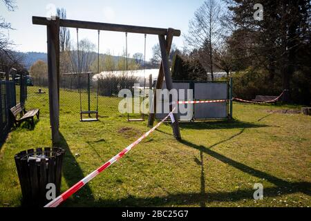Playground equipment roped off in Potzbach, Germany due to corona virus (COVID19). - Stock Photo