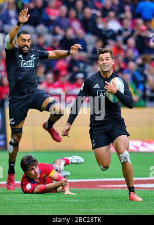 Vancouver, Canada. 7th March, 2020. Andrew Knewstubb #8 of New Zealand gets by Spain tackler in Match #14 during Day 1 - 2020 HSBC World Rugby Sevens - Stock Photo