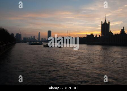 Sunset on the River Thames, looking West from Westminster Bridge - Stock Photo