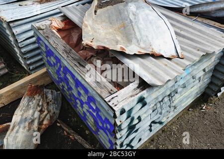 Asbestos from industrial site cleansing & remediation, hazardous material stored on-site in makeshift corrugated iron cases at The Maltings, OH&S, NSW - Stock Photo